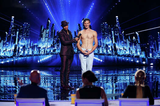AMERICA'S GOT TALENT -- Episode 912 -- Pictured: (l-r) Nick Cannon, Andrey Moraru -- (Photo by: Eric Liebowitz/NBC) Photo: NBC, Eric Liebowitz/NBC / 2014 NBCUniversal Media, LLC.