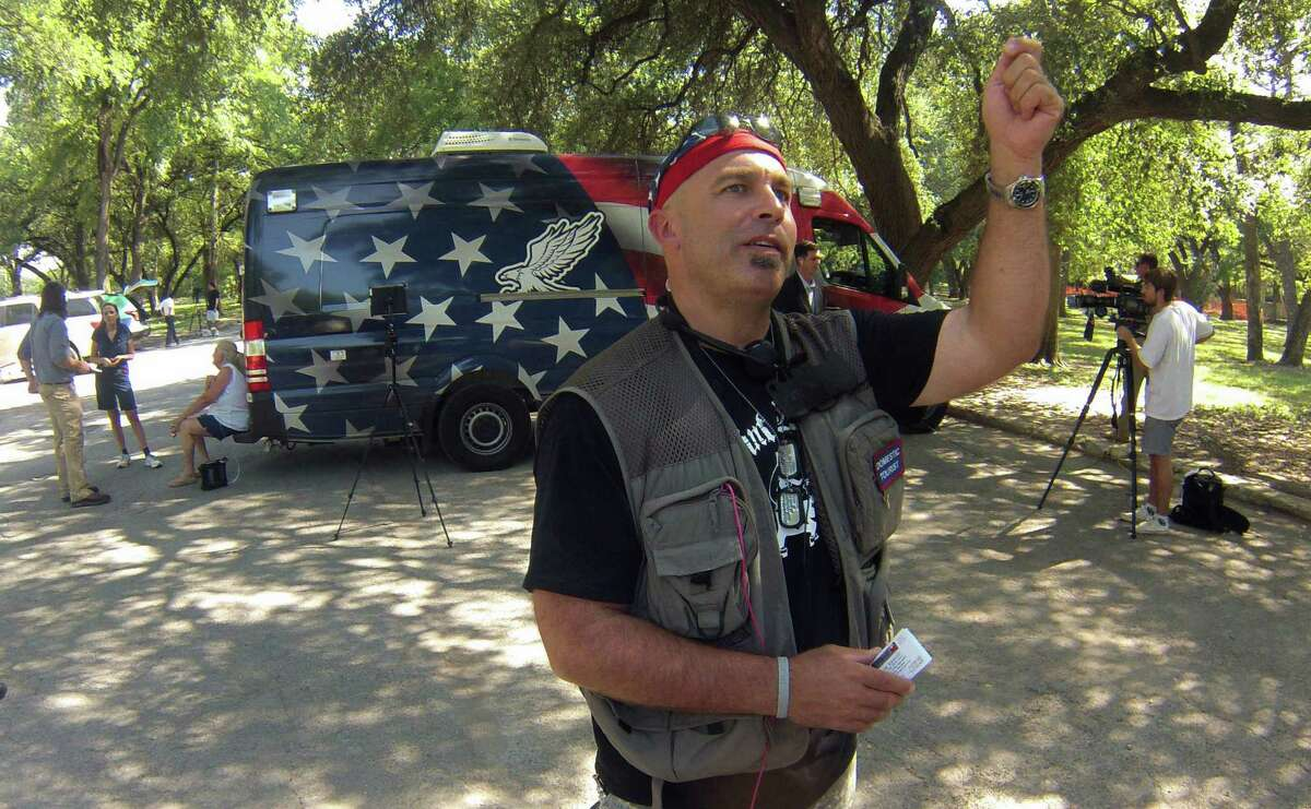 Pete Santilli speaks at Olmos Basin Park after the Border Convoy group, which originated in Murrieta, Calif., arrived on Wednesday afternoon, Aug. 6, 2014.