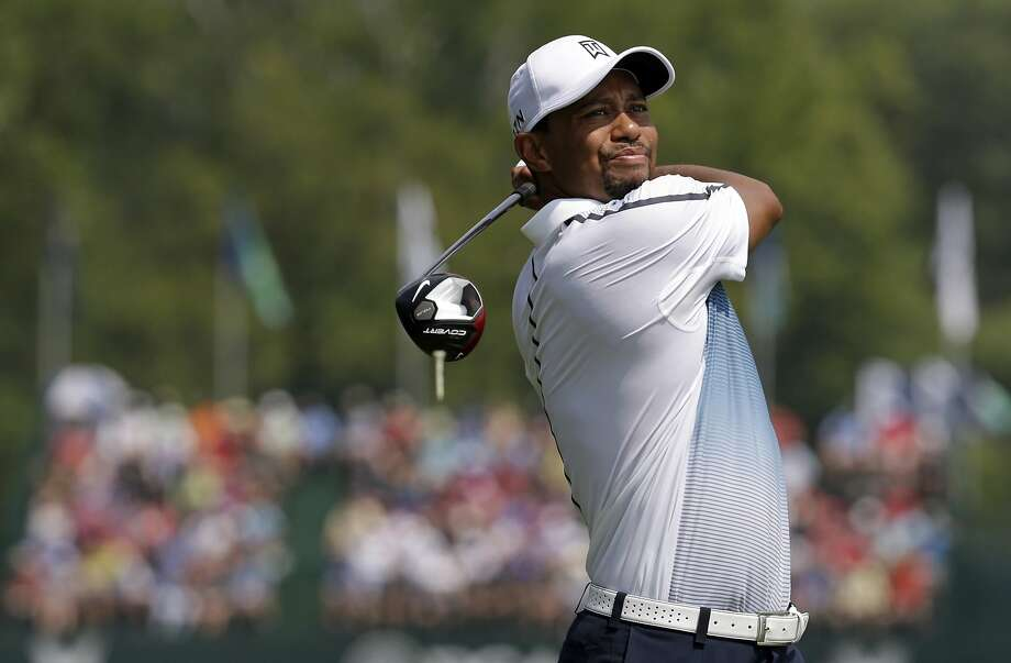 Tiger Woods watches his tee shot on the fifth hole during a practice round at the PGA Championship. Photo: John Locher, Associated Press