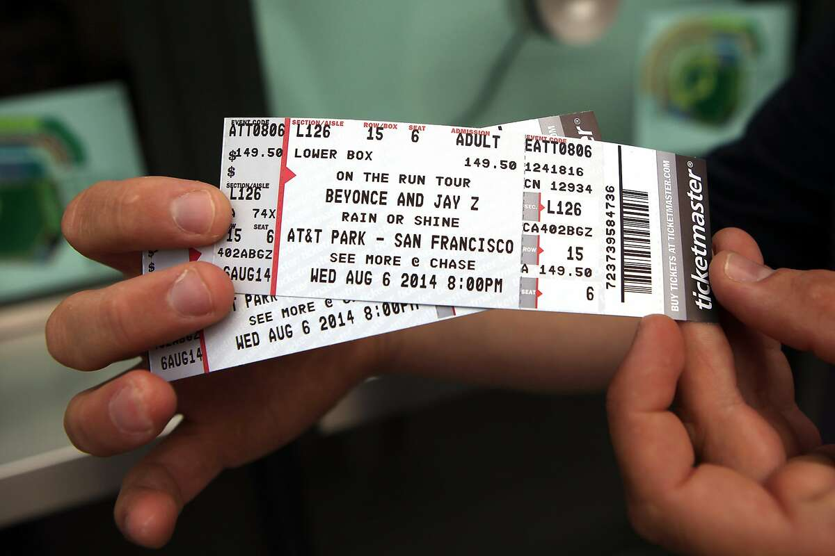 Damien Carlutti, visiting from Toulouse, France, shows off his tickets for the Beyonce and Jay-Z concert at AT&T Park in San Francisco, CA, Wednesday, August 5, 2014.