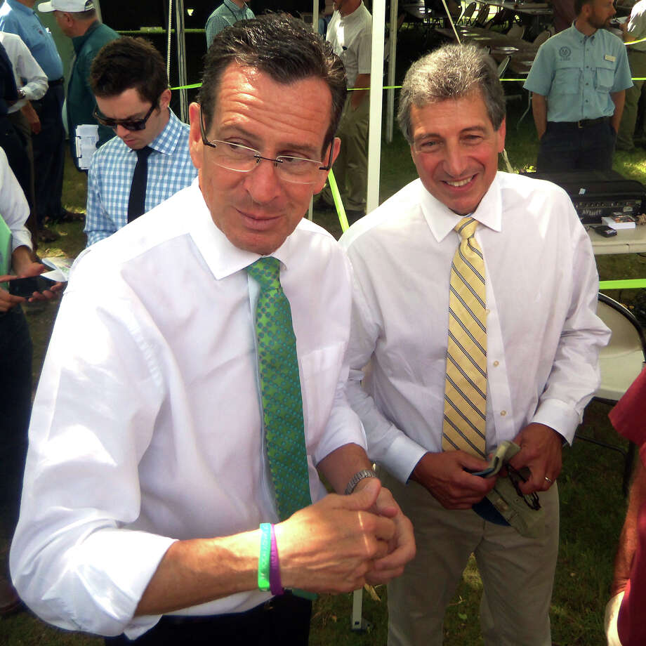 Gov. Dannel Malloy, left, meets visitors to the 104th annual Plant Science Day at the Connecticut Agricultural Experiment Station's Lockwood Farm in Hamden, Conn. on August 6, 2014. With him is Theodore G. Andreadis, Connecticut Agricultural Experiment Station director. Photo: John Burgeson / Connecticut Post