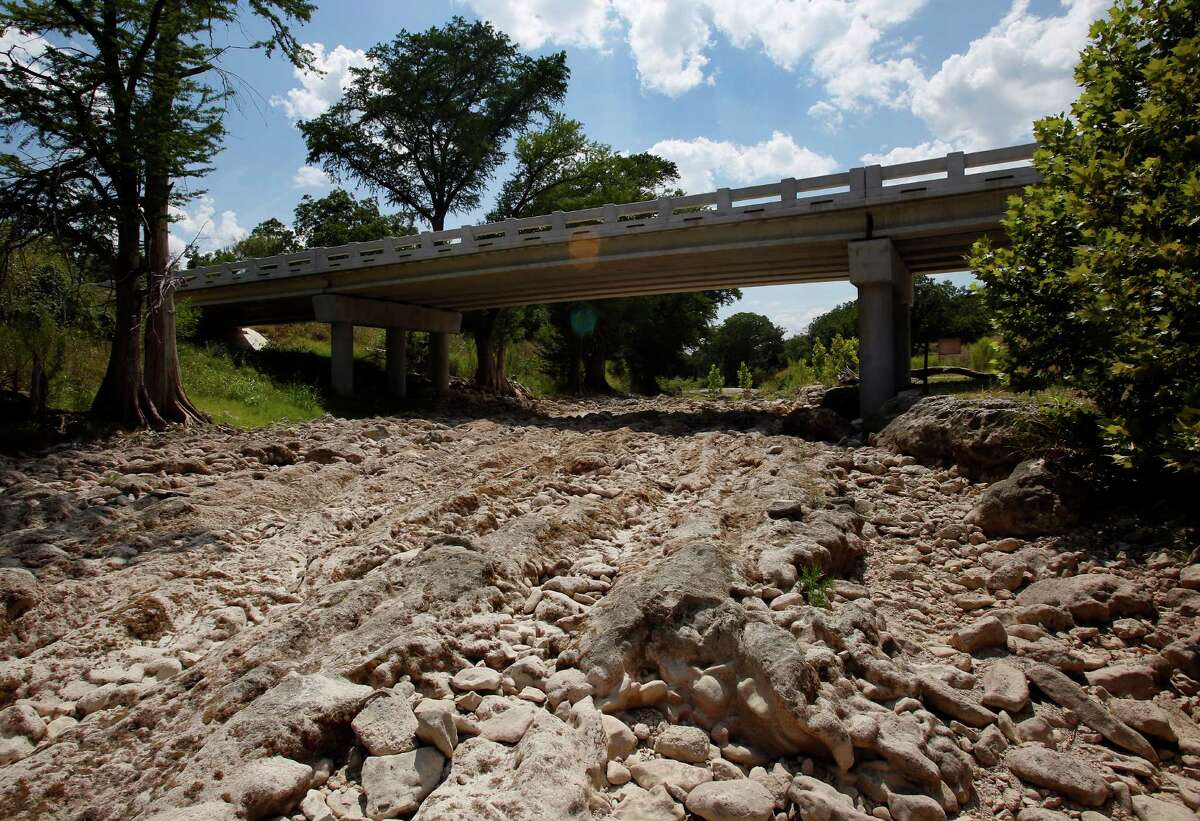 The Guadalupe River has run dry Wednesday Aug. 6, 2014 at the Rebecca Creek Road bridge crossing. A few miles up stream from the bridge the Spring Branch gauge reported a flow of just .14 cubic feet per second at the 4 p.m. reading.