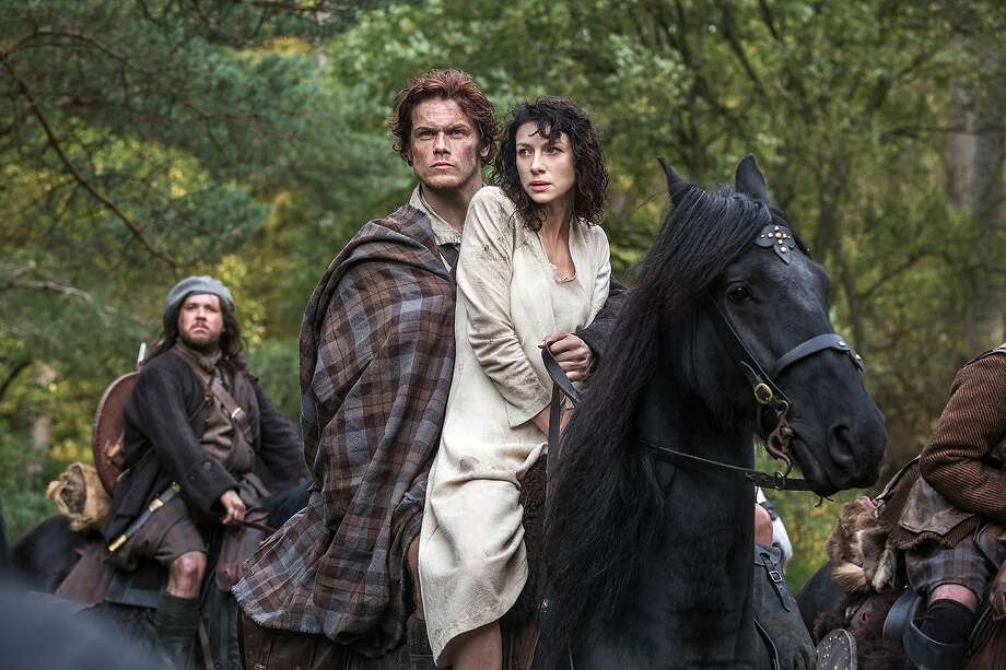 "Jamie Fraser (played by Sam Heughan) and Claire Randall (Caitriona Balfe) in the new Starz show ""Outlander."" Photo: Ed Miller, Associated Press"