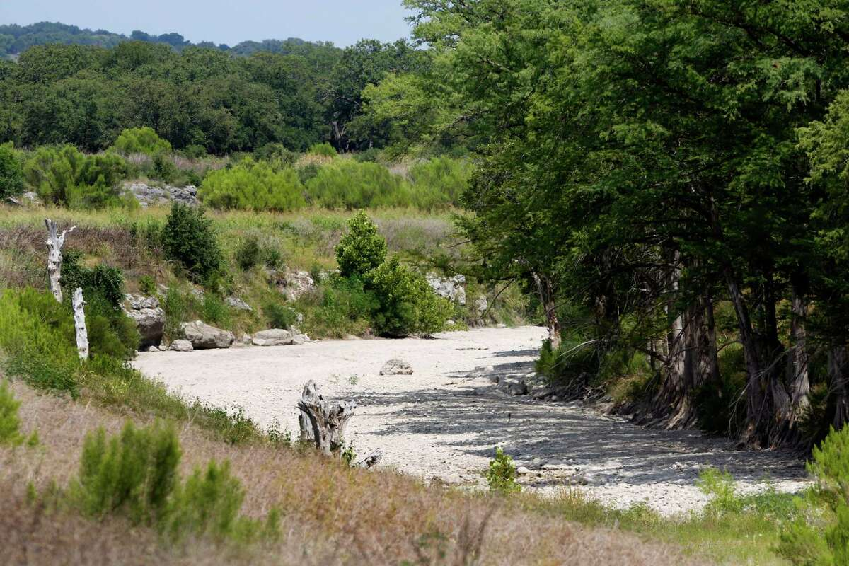 The Guadalupe River has run dry Wednesday Aug. 6, 2014 just down stream from the Rebecca Creek Road bridge crossing. A few miles up stream from the bridge the Spring Branch gauge reported a flow of just .14 cubic feet per second at the 4 p.m. reading.