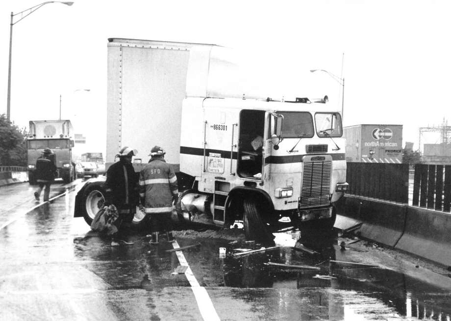 A tractor-trailer jackknifed and burst into flames on Interstate 95 on Aug. 11, 1989 sending fire across the median where stranded commuters were stuck in traffic. The driver of the truck suffered a cut on his head and no one else was hurt. Photo: File Photo/Tom Ryan / Stamford Advocate File Photo