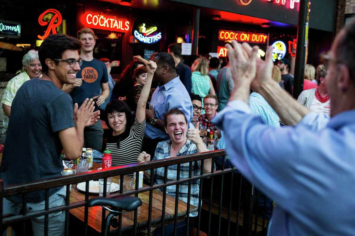 City officials and supporters celebrate the passing of Proposition 1 Tuesday, August 5, 2014, at The 5 Point Cafe in Seattle, Wash. Seattle Proposition 1 creates the Seattle Park District, a metropolitan park district with the same boundaries as the City of Seattle.