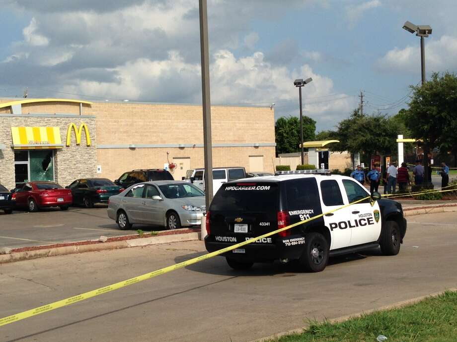 According to early reports, Houston police were involved in a gunfight about 4 p.m. Wednesday outside a McDonald's on Beechnut near Wilcrest. Photo: Mike Glenn/Houston Chronicle