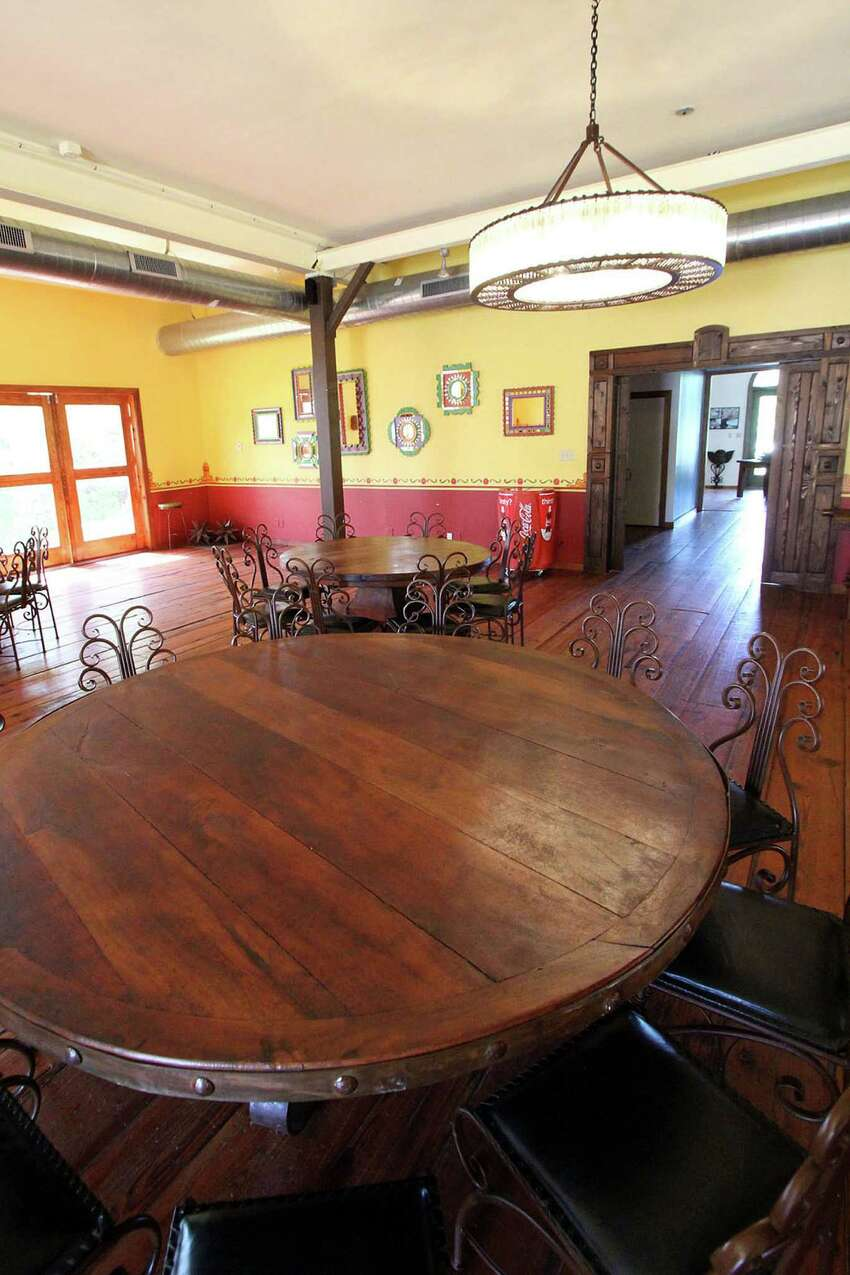 The dining room of Casa Hernán was the former owner's woodshop. Johnny Hernandez finished it out, had the walls painted yellow and red and brought in mesquite tables from Guanajuato. He had a metal worker and glassblower team up to make the two circular chandeliers in the dining room.