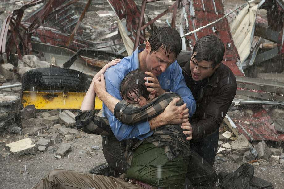 "Max Deacon, Richard Armitage and Nathan Kress find themselves facing ""Into the Storm."" Although Steven Quale's film never forgets the human face of disaster, the special effects are the stars of the show. Photo: Ron Phillips"