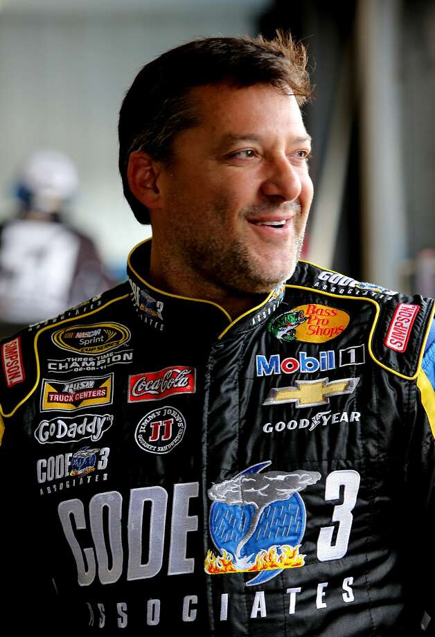 LONG POND, PA - AUGUST 01:  Tony Stewart, driver of the #14 Code 3 / Mobil 1 Chevrolet,waits in the garage during practice for the NASCAR Sprint Cup Series GoBowling.com 400 at Pocono Raceway on August 1, 2014 in Long Pond, Pennsylvania.  (Photo by Jerry Markland/Getty Images) Photo: Jerry Markland, Getty Images