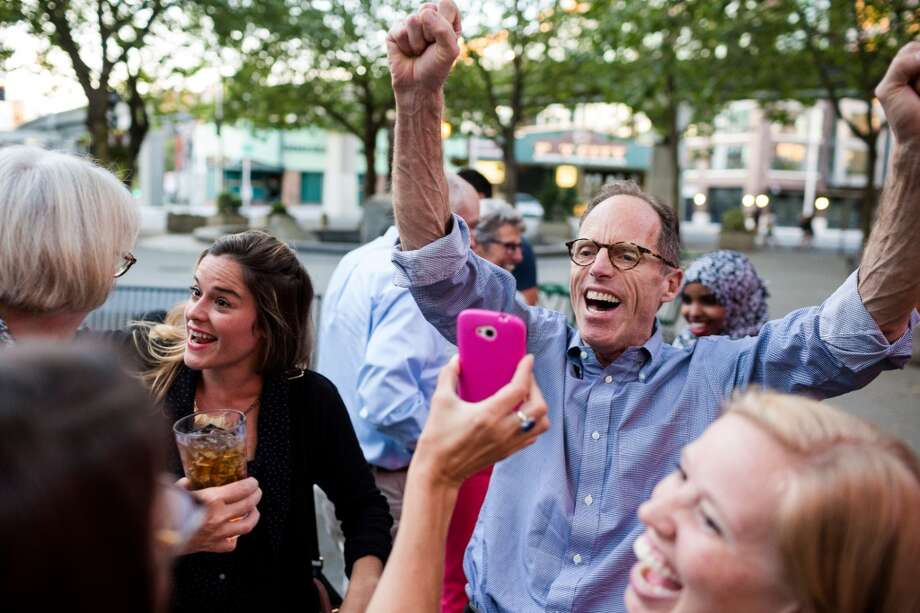 Thatcher Bailey, right, Executive Director at Seattle Parks Foundation, celebrates the passing of Proposition 1 Tuesday, August 5, 2014, at The 5 Point Cafe in Seattle, Wash. Seattle Proposition 1 creates the Seattle Park District, a metropolitan park district with the same boundaries as the City of Seattle. (Jordan Stead, seattlepi.com) Photo: JORDAN STEAD, SEATTLEPI.COM