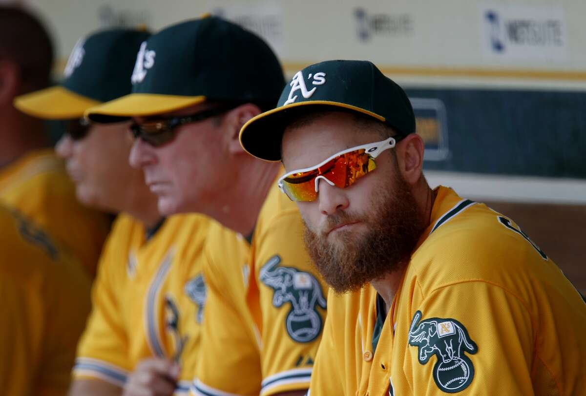 Newly acquired outfielder Jonny Gomes sat on the bench early in the game. The Oakland Athletics battle the Tampa Bay Rays Wednesday August 6, 2014 at the O.co coliseum.