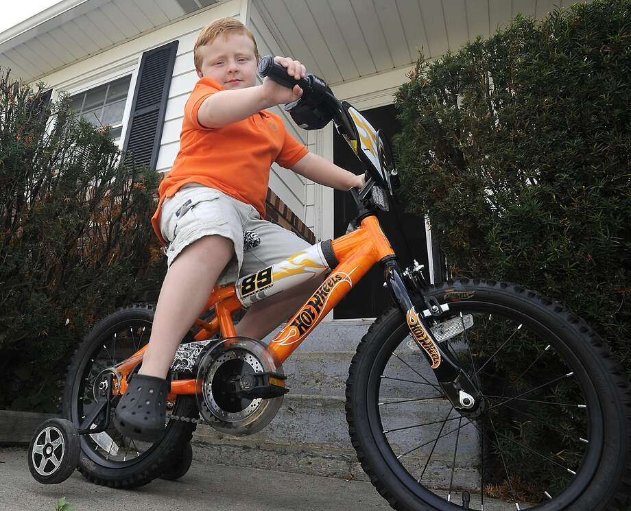 Noah Ritter, 5, poses with his bicycle outside his home in Wilkes-Barre, Pa. on Tuesday, Aug. 5, 2014. Photo: Mark Moran, Associated Press