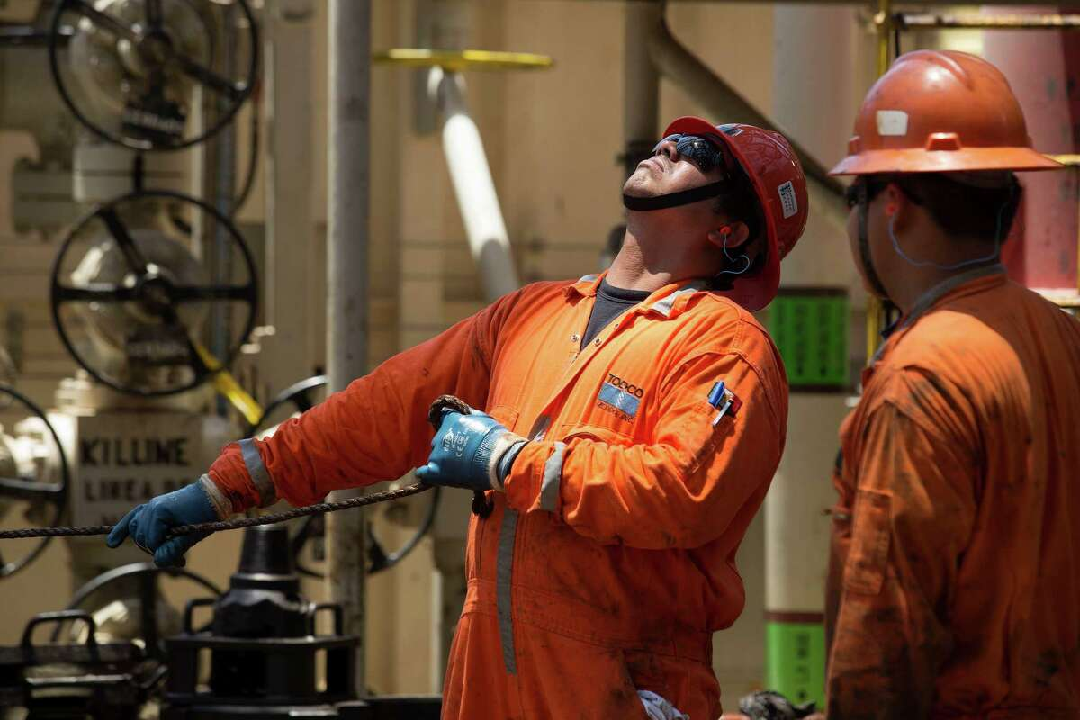 A worker changes a drill pipe on a Pemex rig. Analysts say that under Mexico's new energy laws, Pemex likely will keep core assets and prospects it has the resources to develop.