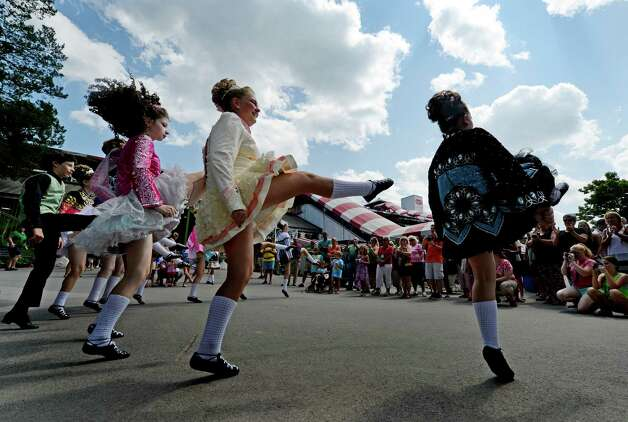Members of the Boland School of Dance based in Troy strut their Irish stuff for Irish Heritage Day Wednesday Aug. 6, 2014 at the Saratoga Race Course in Saratoga Springs, New York.    (Skip Dickstein/Times Union) Photo: SKIP DICKSTEIN