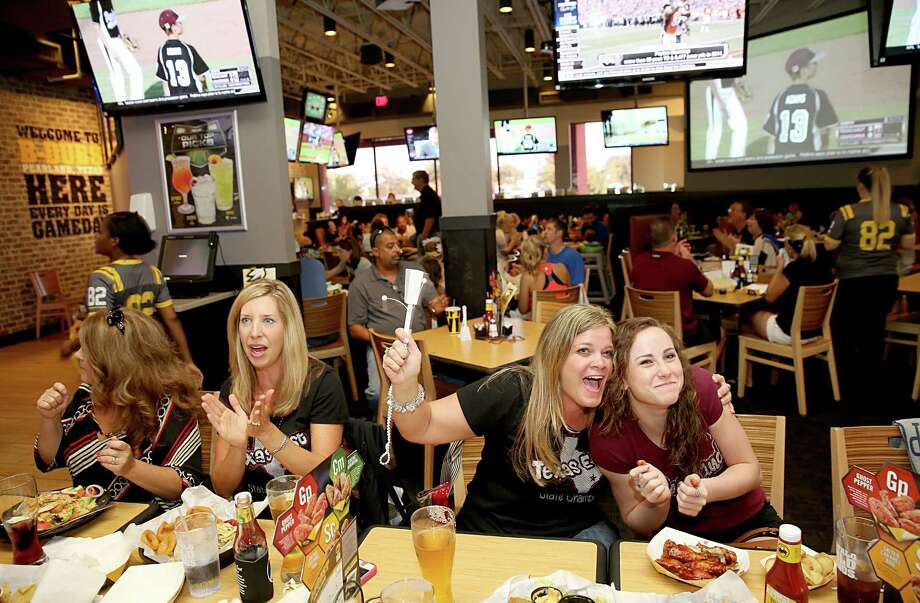 8/6/2014: From left to right, Jennifer Raffety, Annalea Young and Jordan Groover cheer as Pearland scores against Lake Charles at the Buffalo Wild Wings watch party in Pearland for the Pearland East Little League team, which is playing in the Southwest Regional final in Waco, TX. Jordan's brother is Michael Groover who is the third baseman for Pearland. Photo: Thomas B. Shea, For The Chronicle / © 2014 Thomas B. Shea