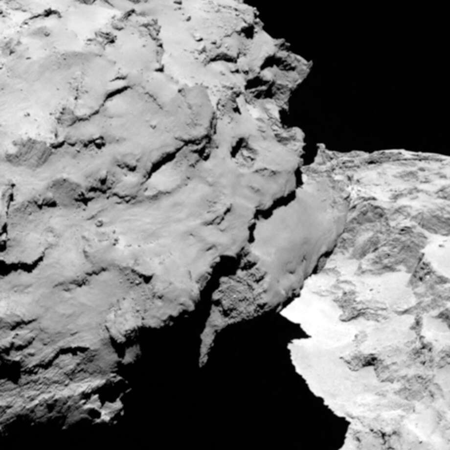 This image was taken by Rosetta's OSIRIS narrow-angle camera Aug. 6. It shows the comet's 'head' at the left of the frame, which is casting shadow onto the 'neck' and 'body' to the right. Photo: Uncredited, HOPD / European Space Agency