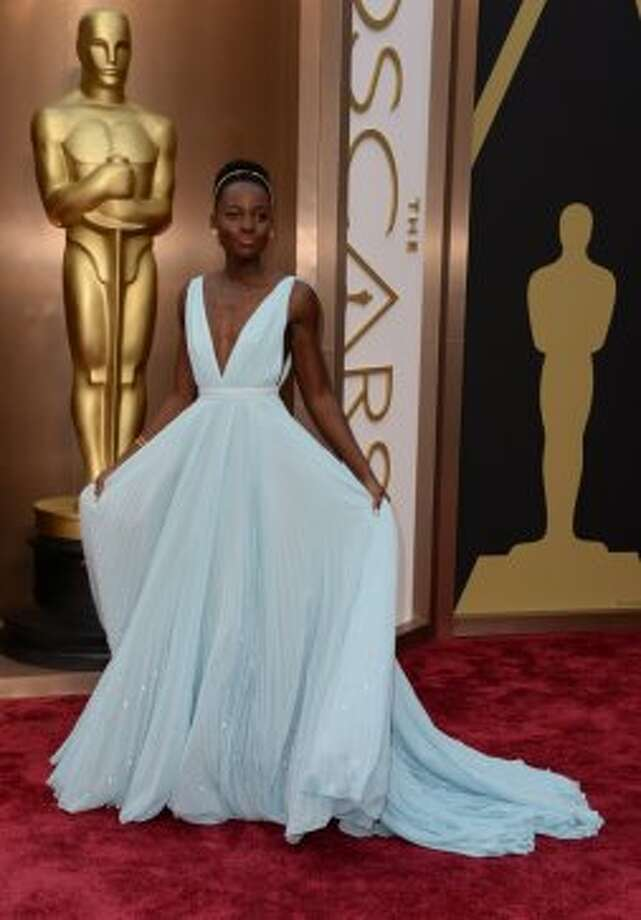 "Made VF the list! Nominee for Best Supporting Actress in ""12 Years a Slave""  Lupita Nyong'o arrives on the red carpet for the 86th Academy Awards on March 2nd, 2014 in Hollywood, California. AFP PHOTO / Robyn BECKROBYN BECK/AFP/Getty Images Photo: ROBYN BECK, AFP/Getty Images"