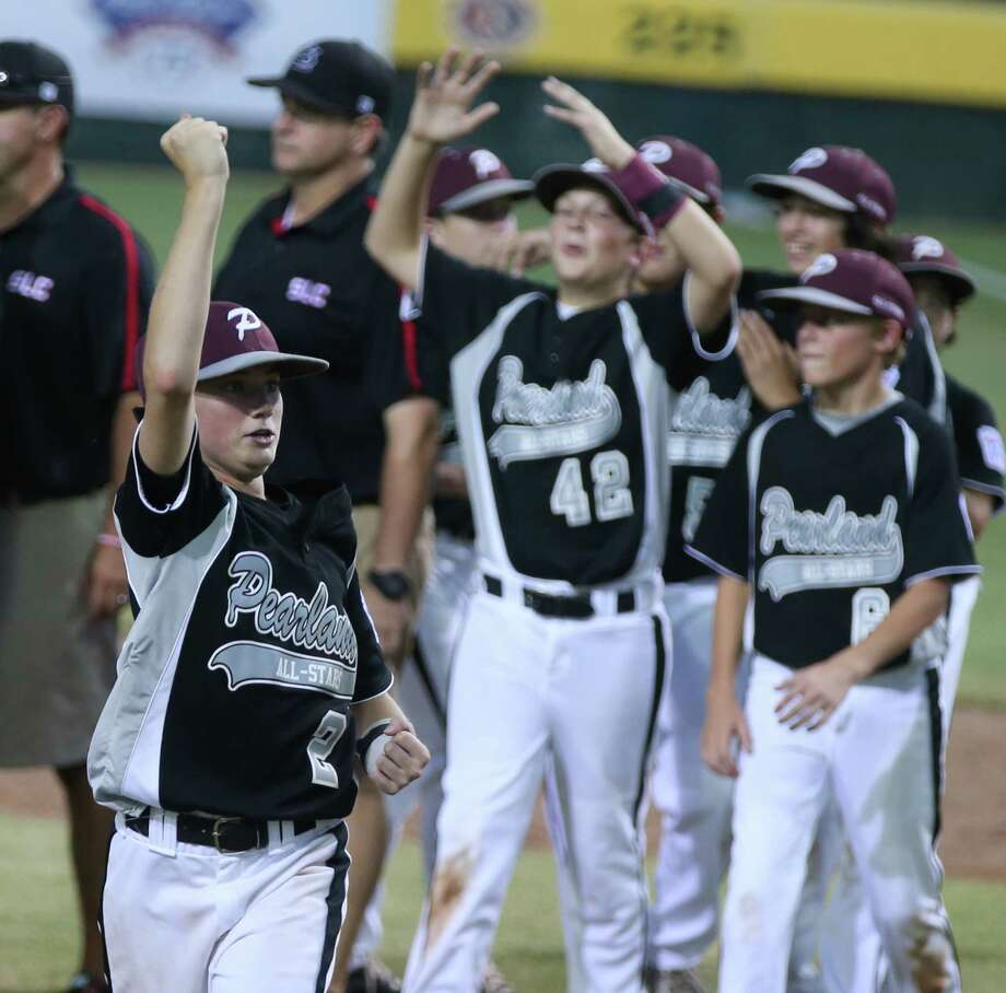 Texas East's Michael Groover, left, celebrates the team's 7-3 win over Louisiana following the Southwestern Little League baseball regional championship game, Wednesday, Aug. 6, 2014, in Waco, Texas. (AP Photo/Waco Tribune Herald, Rod Aydelotte) Photo: Rod Aydelotte, Associated Press / Waco Tribune Herald