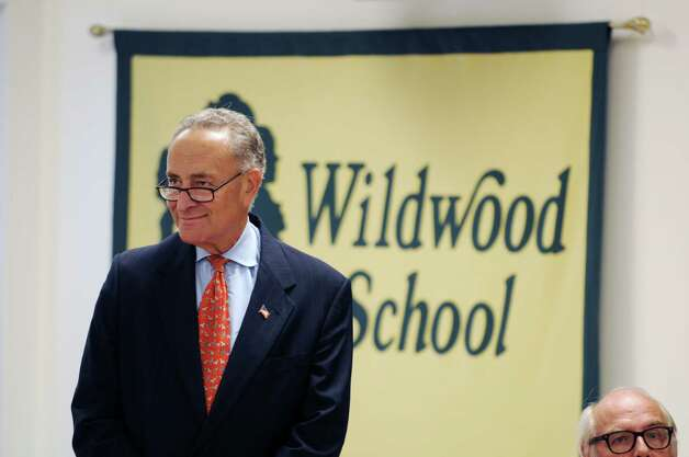Sen. Charles Schumer arrives for a press conference Wednesday afternoon, Aug. 6, 2014, at Wildwood Programs in Guilderland, N.Y., where he called for passage of a bill to create IRA-like savings accounts to help parents of disabled kinds save money for their care, the Achieving a Better Life Experience Act (ABLE). (Will Waldron/Times Union) Photo: WW