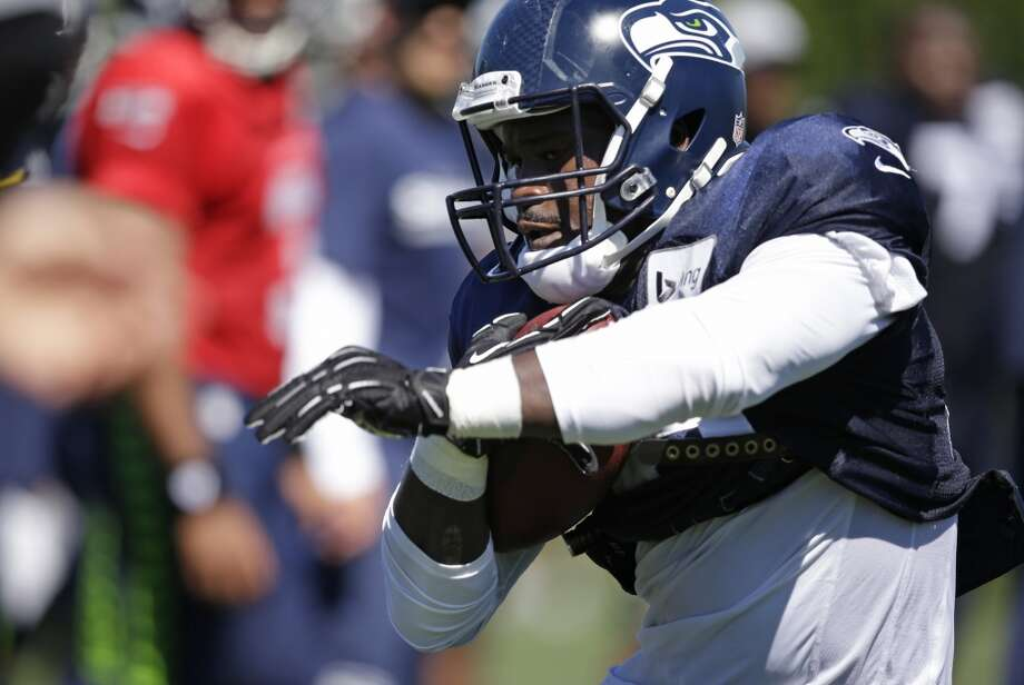 Seahawks running back Christine Michael runs at Seahawks training camp on Wednesday, June 30. Photo: Elaine Thompson, Associated Press