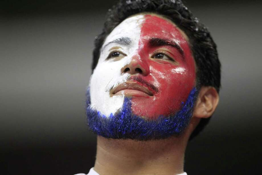 "Alejandro Moran brightly supports his team at Wednesday night's ""friendly"" game between Chivas and AC Milan at NRG Stadium in Houston. Photo: Johnny Hanson / Houston Chronicle"