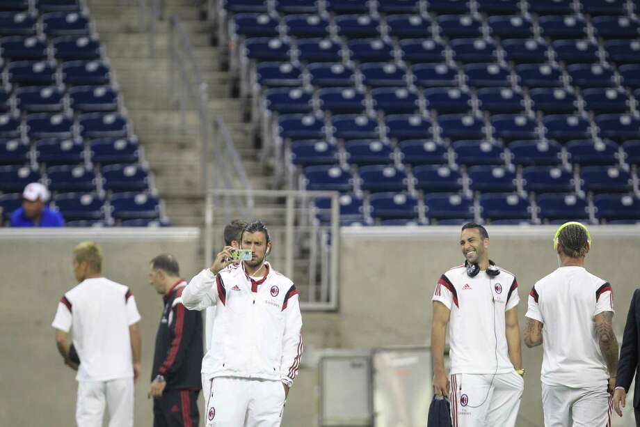 "A.C. Milan players take in NRG Stadium before Wednesday night's ""friendly"" game against Chivas. Photo: Johnny Hanson / Houston Chronicle"