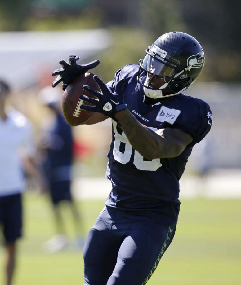 Wide receiver Phil Bates reaches for a pass at Seahawks training camp. Photo: Elaine Thompson, Associated Press