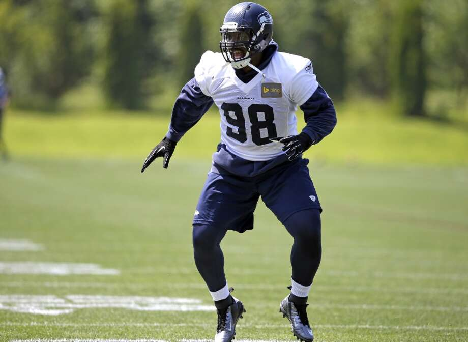 Defensive lineman Greg Scruggs works out at Seahawks OTAs in June. Photo: Elaine Thompson, Associated Press