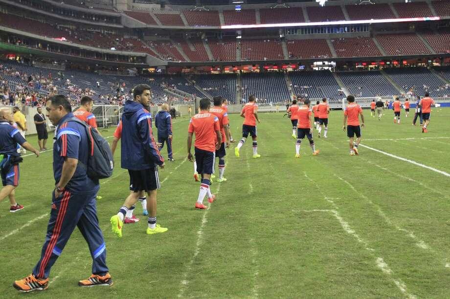 "AC Milan gets ready to start Wednesday night's ""friendly"" game against Chivas at NRG Stadium in Houston. Photo: Johnny Hanson / Houston Chronicle"
