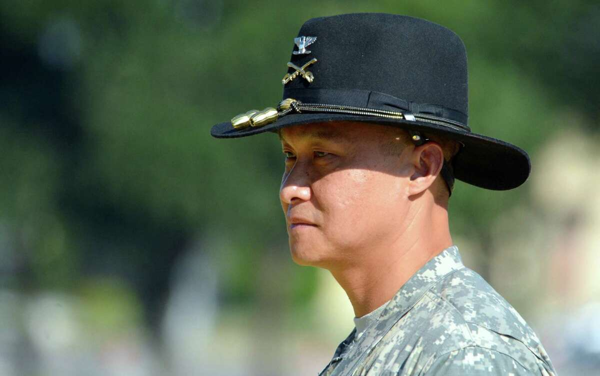 Col. Viet Luong attends his promotion ceremony, Wednesday, Aug. 6, 2014 in Fort Hood, Texas. Luong has become the first Vietnamese-American to reach the rank of general in the U.S. Army. (AP Photo/Killeen Daily Herald, Bryan Correira)