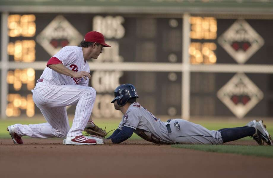 August 6: Phillies 10, Astros 3Second baseman Jose Altuve slides in safely under the tag of second baseman Chase Utley in the top of the first inning. Photo: Mitchell Leff, Getty Images