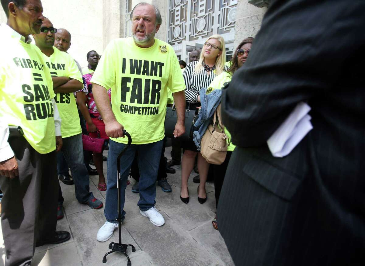 Bob Kuter, a taxi driver for 30 years, shows his disappointment outside City Hall after Houston officials approved new ride regulations on Aug. 6, 2014.