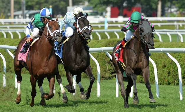 #1 Tricky Hat ridden by jockey Rosie Napravnik finds room on the rail to win the 11th running of the John's Call by a whisker Wednesday Aug. 6, 2014 at the Saratoga Race Course in Saratoga Springs, New York.    (Skip Dickstein/Times Union) Photo: SKIP DICKSTEIN