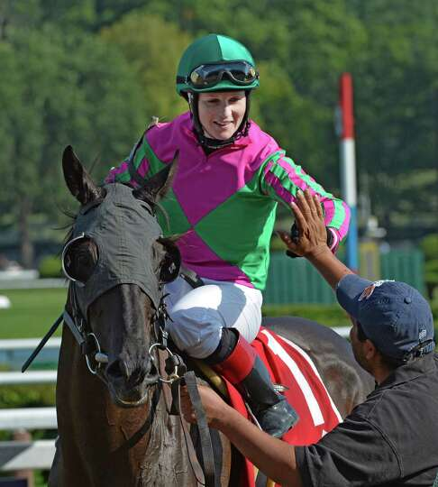Jockey Rosie Napravnik sits atop #1 Tricky Hat and receives congratulations from connection after wi