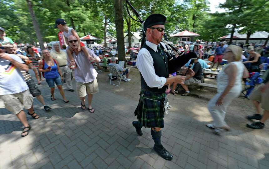 Piper Bill Munro draws a crowd on Irish Heritage Day Wednesday Aug. 6, 2014 at the Saratoga Race Cou