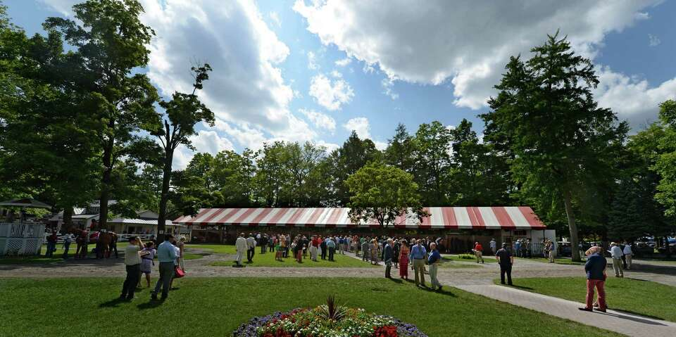 A beautiful cloud formation hangs over the paddock Wednesday Aug. 6, 2014 at the Saratoga Race Cours