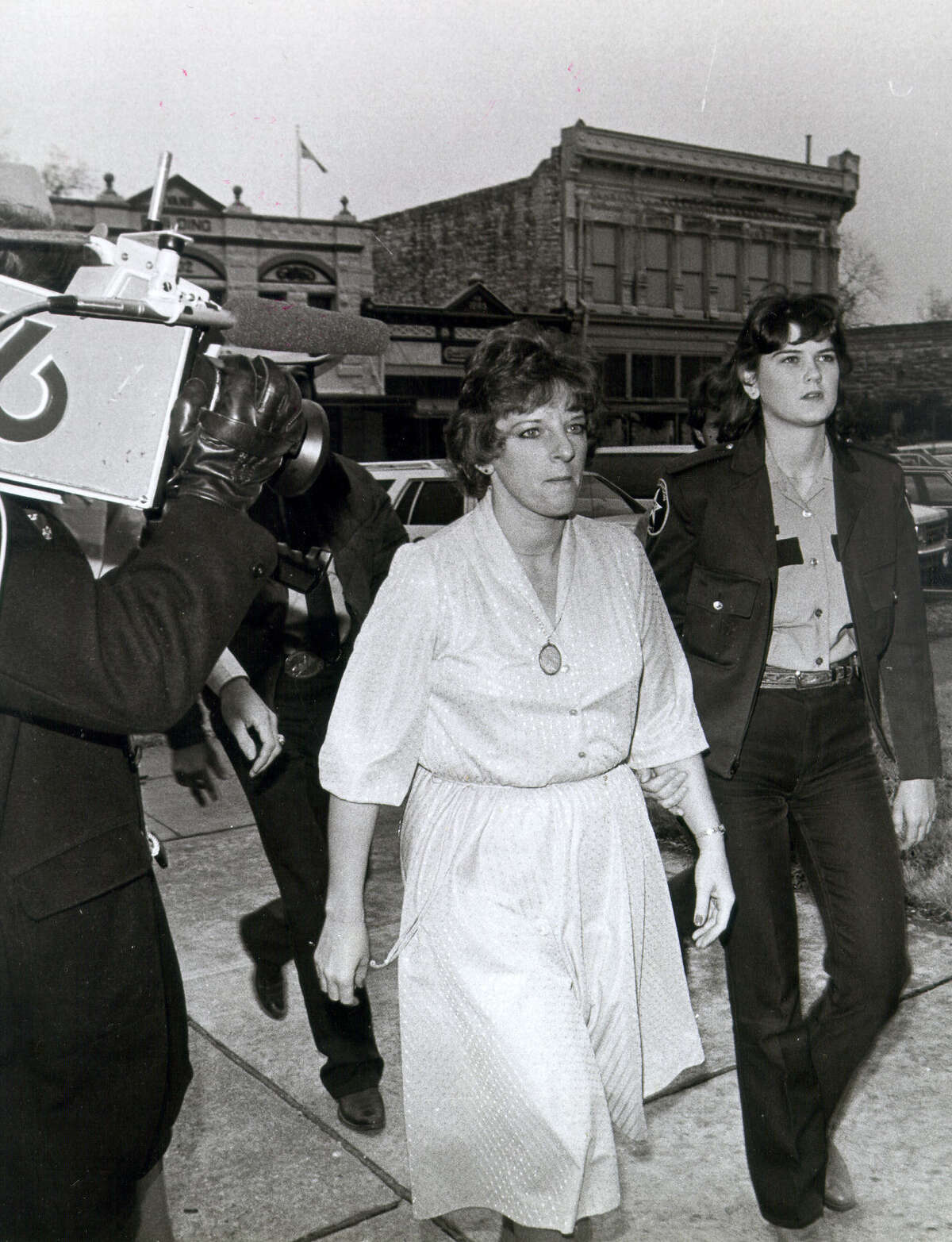 In this photo from 1984, Genene Jones - in the company of a deputy - arrives for her trial at the Williamson County Courthouse. Although suspected in the deaths of 40 babies, Jones was convicted in the death of just one.