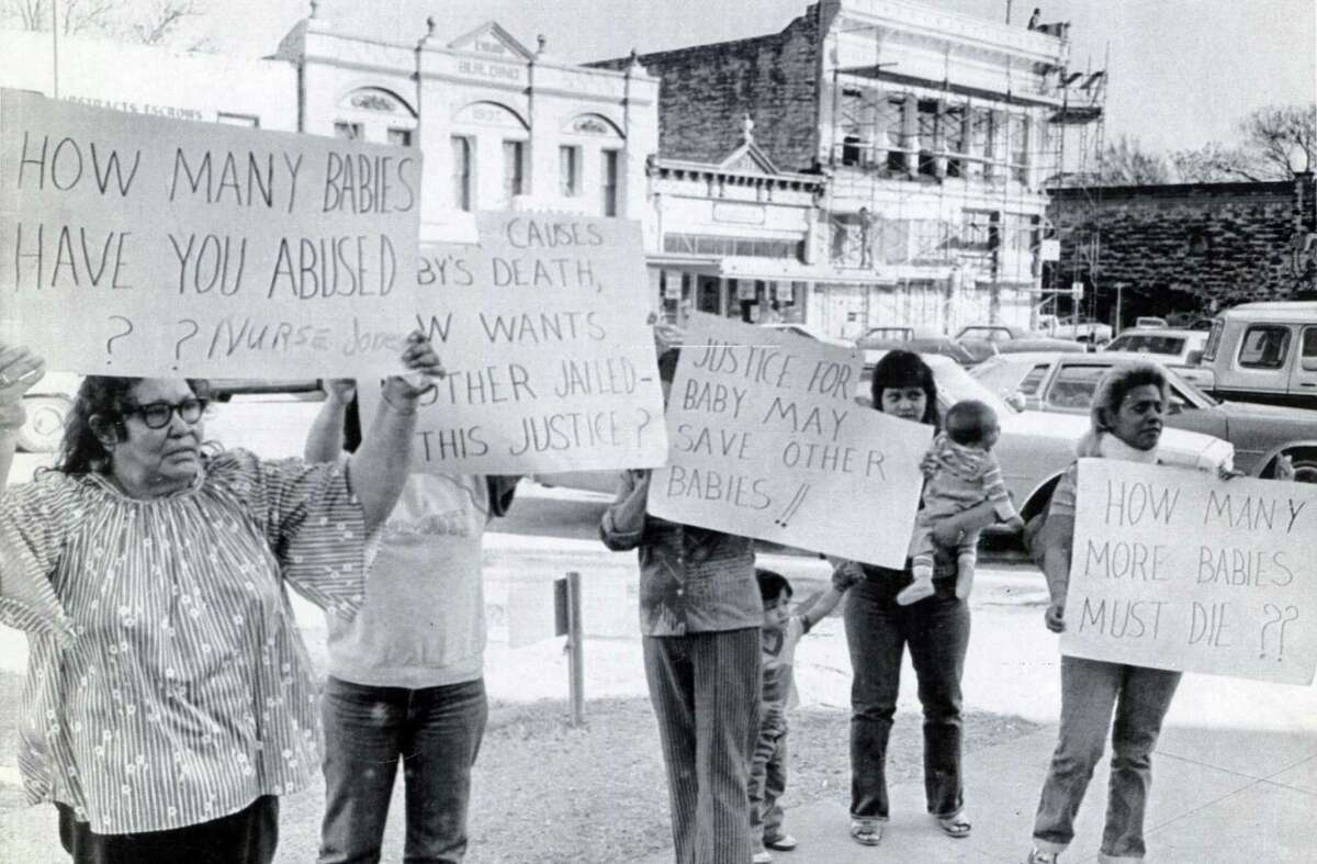 As the last phase of Genene Jones' 1984 trial began, protesters carried signs at the courthouse in Georgetown.