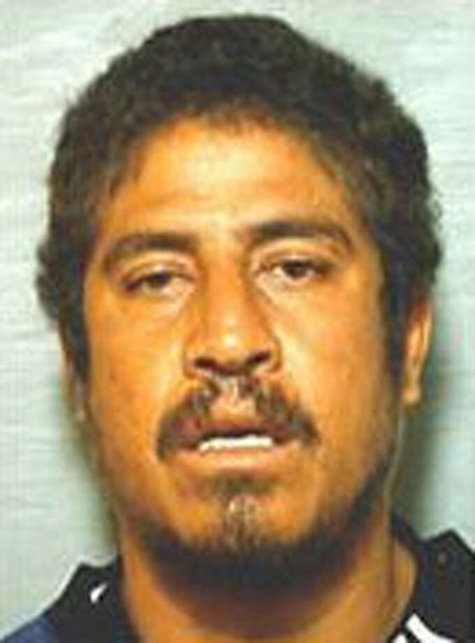 Jose Lopez is accused of slashing his wife's face and stabbing her in the stomach July 5. Photo: Courtesy Photo.