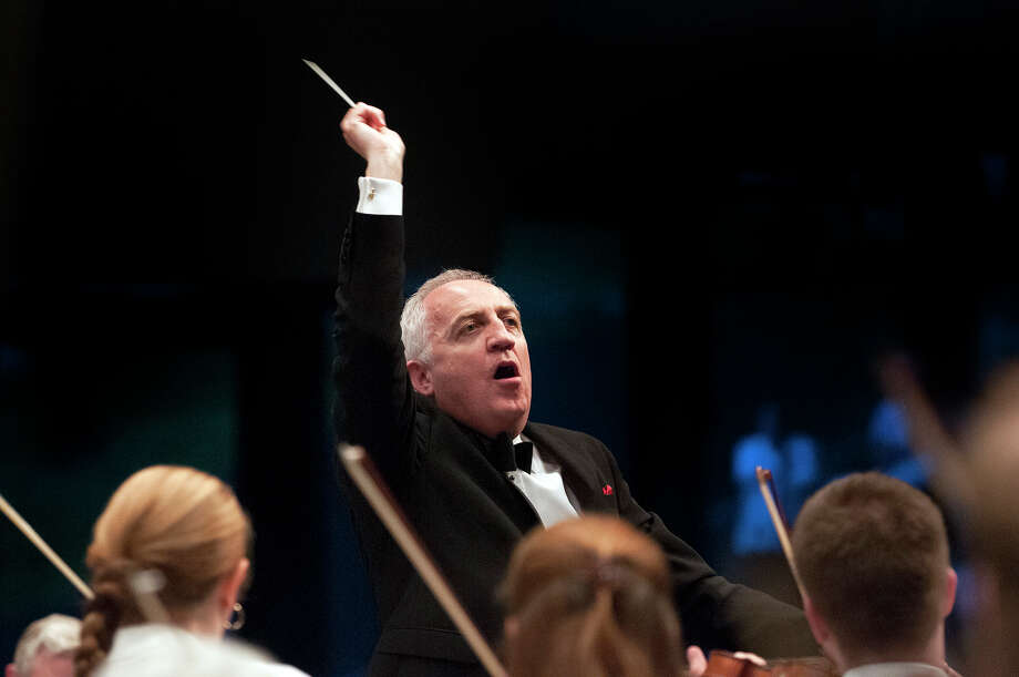 Conductor Bramwell Tovey conducts the Philadelphia Orchestra during the playing of the Star Spangled Banner on Wednesday, August 6, 2014 at the Saratoga Performing Arts Center in Saratoga Springs, N.Y.  (Tom Brenner/ Special to the Times Union) Photo: Tom Brenner / ©Tom Brenner/ Albany Times Union