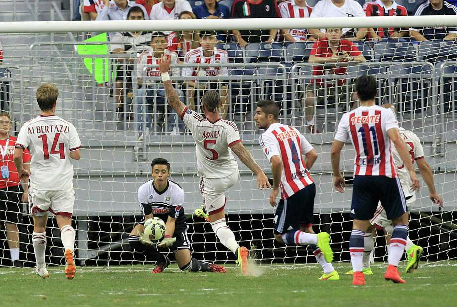 Chivas goal keeper Antonio Rodriguez (1) makes a save from a kick by A.C. Milan defender Philippe Mexes (5) as A.C. Milan played Chivas de Guadalajara in an international friendly soccer game at NRG Stadium Wednesday, Aug. 6, 2014, in Houston. Photo: Johnny Hanson, Houston Chronicle / © 2014  Houston Chronicle