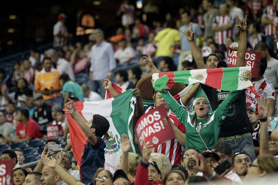 Chivas fans cheer as A.C. Milan played Chivas de Guadalajara in an international friendly soccer game at NRG Stadium Wednesday, Aug. 6, 2014, in Houston. Photo: Johnny Hanson, Houston Chronicle / © 2014  Houston Chronicle