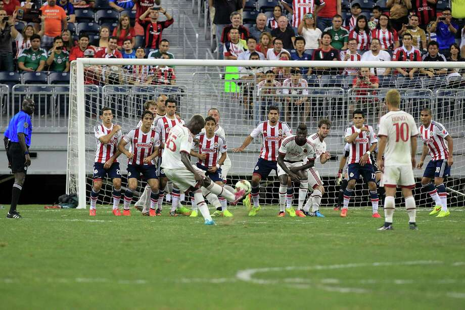 A.C. Milan forward Mario Balotelli (45) scores on a penalty kick in the first half as A.C. Milan played Chivas de Guadalajara in an international friendly soccer game at NRG Stadium Wednesday, Aug. 6, 2014, in Houston. Photo: Johnny Hanson, Houston Chronicle / © 2014  Houston Chronicle