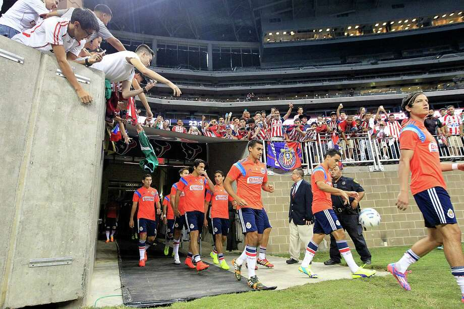 Chivas de Guadalajara walk onto the field before they played A.C. Milan in an international friendly soccer game at NRG Stadium Wednesday, Aug. 6, 2014, in Houston. Photo: Johnny Hanson, Houston Chronicle / © 2014  Houston Chronicle