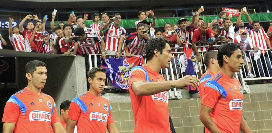 C.D. Guadalajara enters the field as A.C. Milan played Chivas de Guadalajara in an international friendly soccer game at NRG Stadium Wednesday, Aug. 6, 2014, in Houston. Photo: Johnny Hanson, Houston Chronicle / © 2014  Houston Chronicle