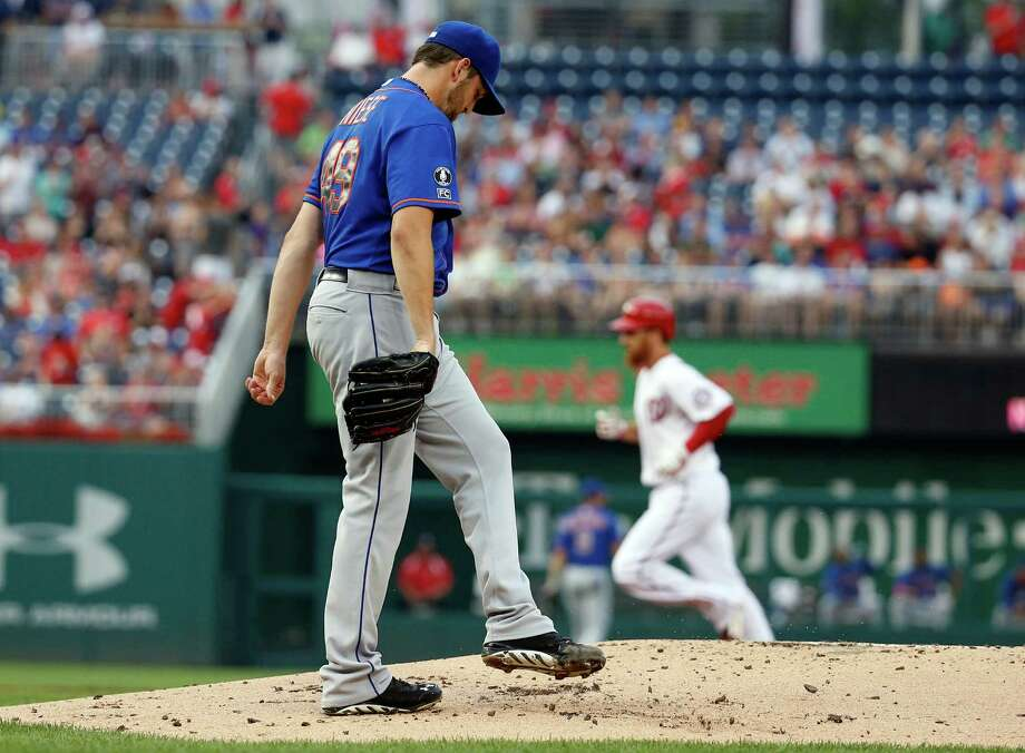 New York Mets starting pitcher Jonathon Niese walks back to the mound as Washington Nationals' Adam LaRoche rounds the bases for his two-run homer during the first inning of a baseball game at Nationals Park Wednesday, Aug. 6, 2014, in Washington. (AP Photo/Alex Brandon) ORG XMIT: NAT103 Photo: Alex Brandon / AP