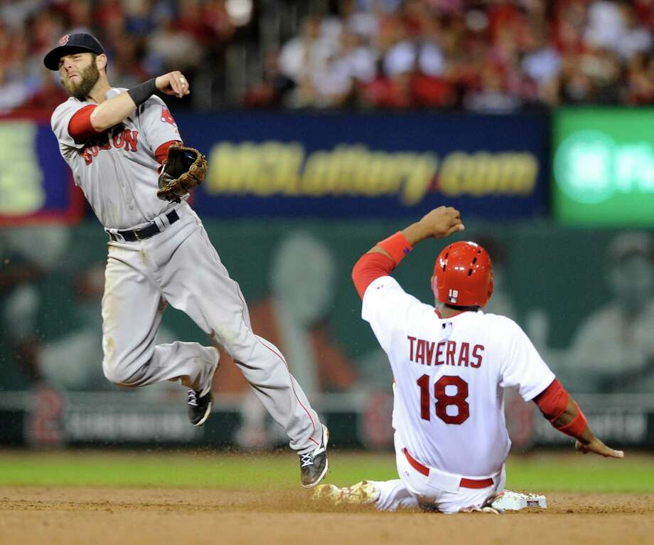 Boston Red Sox's Dustin Pedroia, left, forces St. Louis Cardinals' Oscar Taveras at second and completes the double play to get Cardinals' Jon Jay at first in the second inning in a baseball game, Wednesday, Aug. 6, 2014, at Busch Stadium in St. Louis. (AP Photo/Bill Boyce) ORG XMIT: MOBB106 Photo: Bill Boyce / FR84052 AP