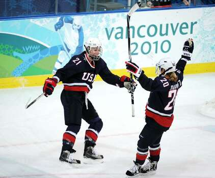VANCOUVER, BC - FEBRUARY 18:  Hilary Knight of the United States celebrates her goal with teammate Natalie Darwitz to make it 5-0 during the ice hockey women's preliminary game between USA and Finland on day 7 of the 2010 Vancouver Winter Olympics at UBC Thunderbird Arena on February 18, 2010 in Vancouver, Canada.  (Photo by Harry How/Getty Images) *** Local Caption *** Hilary Knight;Natalie Darwitz Photo: Harry How, Getty Images / 2010 Getty Images