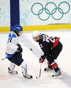 VANCOUVER, BC - FEBRUARY 18: Kerry Weiland of USA battles for the puck with Venla Hovi of Finland during the ice hockey women's preliminary game between USA and Finland on day 7 of the 2010 Vancouver Winter Olympics at UBC Thunderbird Arena on February 18, 2010 in Vancouver, Canada.  (Photo by Harry How/Getty Images) *** Local Caption *** Kerry Wieland;Venla Hovi Photo: Harry How, Getty Images / 2010 Getty Images